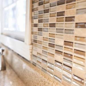 glass and natural stone tiles for a kitchen backsplash