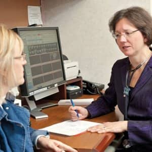 Dr. Lynne Shuster with the Mayo Clinic in Rochester, Minn., consults with a patient.