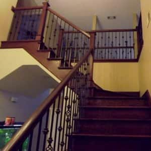 The pro this member hired hand-stained the entire new bannister and steps after adding new wrought-iron balusters. (Photo courtesy of Angie's List member Robert F. of Allen, Texas)