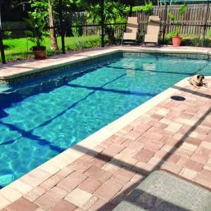 swimming pool with paver deck