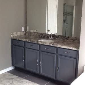 Ceramic or stone tile, vinyl and concrete are perfect flooring options for bathrooms, kitchens, basements and other rooms where water is present. (Photo courtesy of Angie's List member Martha K. of League City, Texas)