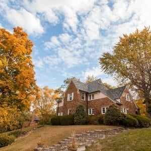 fall trees next to old home (Photo by Brandon Smith)