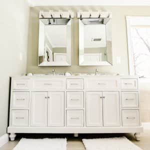 white glazed bathroom sink vanity and cabinets