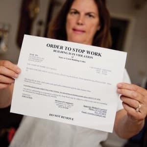 City inspectors posted a stopwork order at Margaret Bell's home after noting her contractor did not have a permit. (Photo by Brandon Smith)