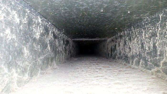 Interior photo of an air duct in need of cleaning.