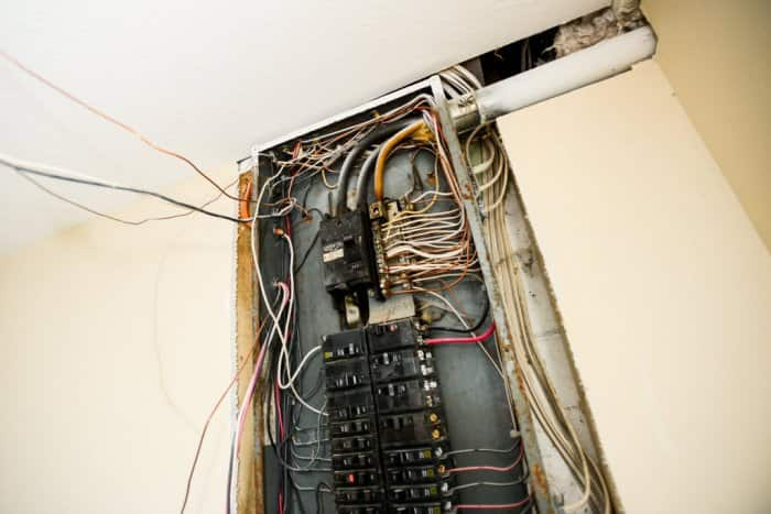 circuit breaker box with exposed wiring