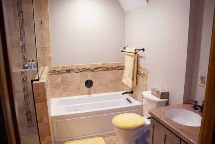 bathroom with yellow accessories