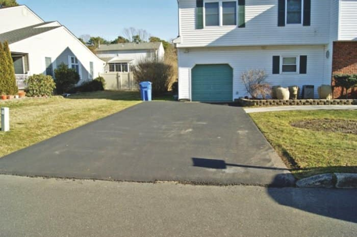 asphalt driveway installed by a scam artist contractor