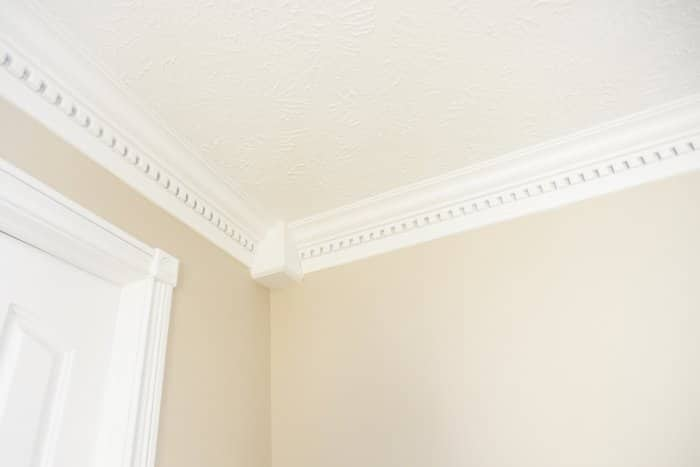 Door Casing And Crown Molding On A Wall