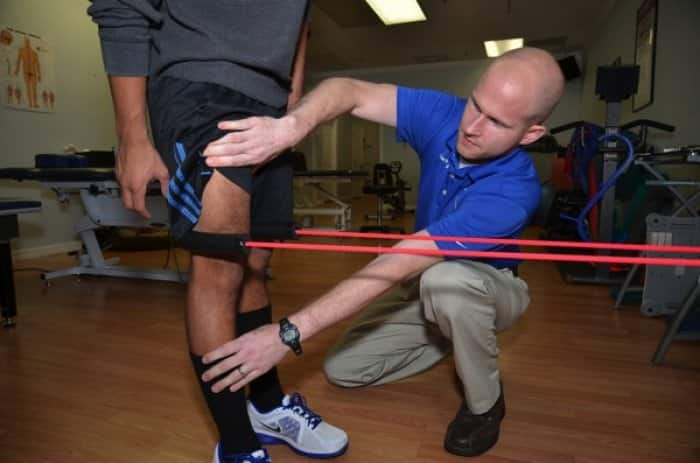 Physical therapist Ryan Whelton, owner of Sport and Spine Physical Therapy and Wellness Center in Tampa, helps patient Jose Manzo rehab his knee following ACL reconstruction. (Photo by Dennis Gregg)