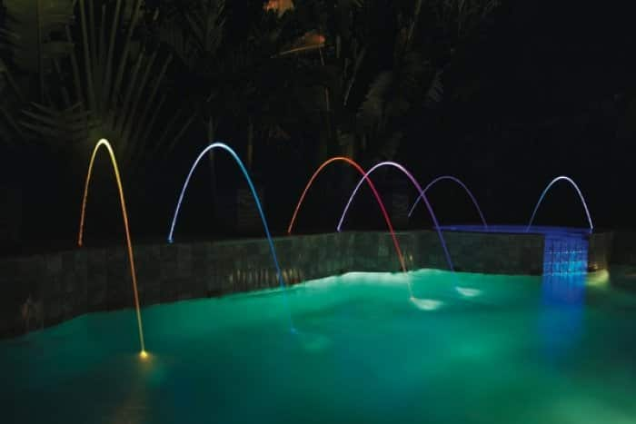 A feature gaining popularity is Pentair's MagicStream Laminars, which produce an arc of water illuminated by LED lights. (Photo courtesy of Pentair Aquatic Systems)