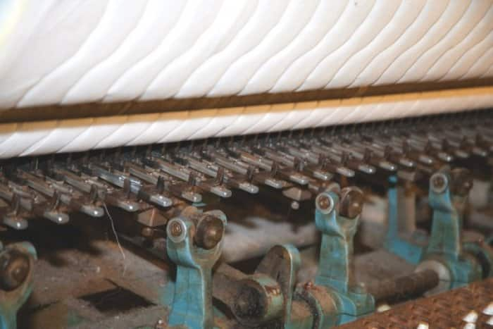 The border quilt machine is just one step among many to create new beds. (Photo by Steve C. Mitchell)