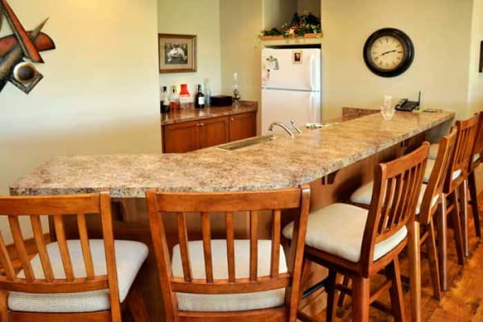 basement remodel with kitchen bar and barstools