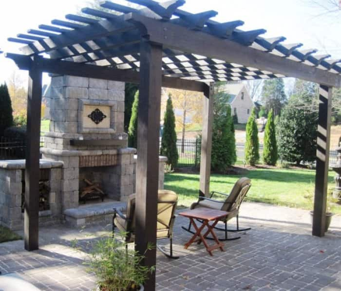 A pergola provides open space to accompany an outdoor fireplace, while still providing cover. (Photo courtesy of Angie's List member Candace R. of Waxhaw, N.C.)