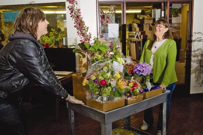 Pat Hutchins (right) of Flowers in Flight in Portland, Ore., readies her store's one-of-a-kind bouquets for delivery. (Photo by James Holk)
