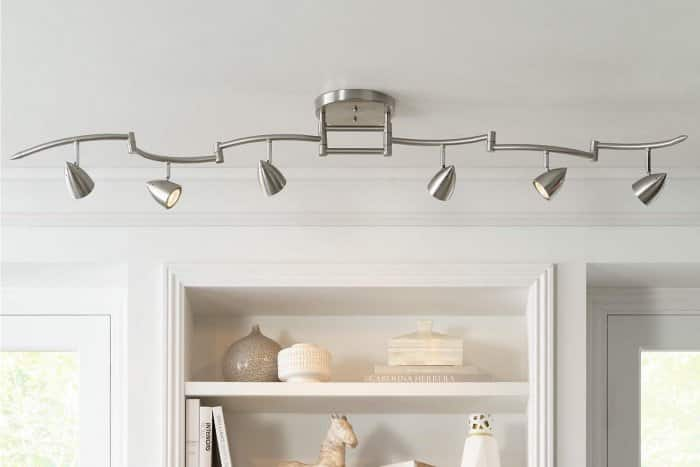 Track lighting above built-in shelving