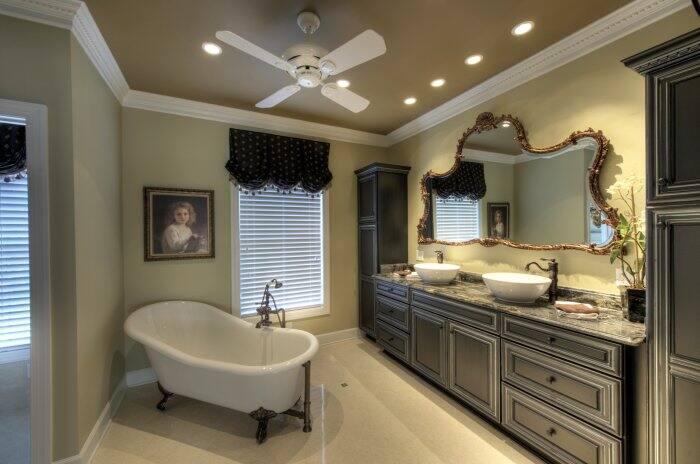 bathroom with vessel sinks and vintage mirror