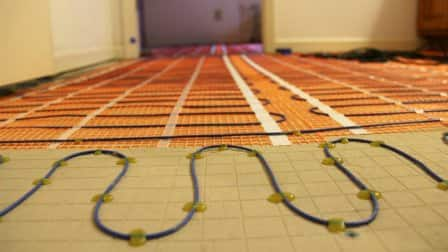 radiant heating coil system installation in bathroom floor