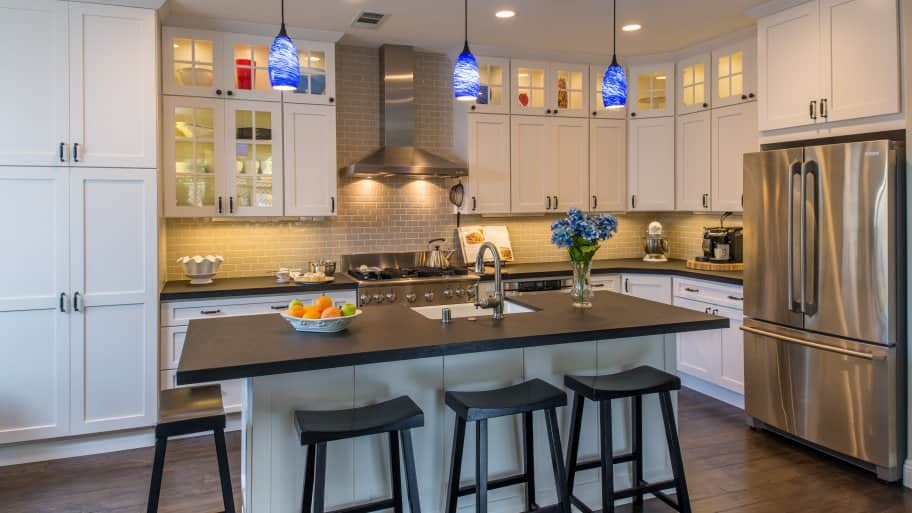 kitchen with stacked cabinets and island