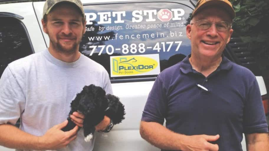 Mike Sinteff (right) has installed hidden fencing in the Atlanta area for nearly 20 years. His son, Adam, is one of the family members who work for the company. (Photo courtesy of Mike and Teresa Sinteff)