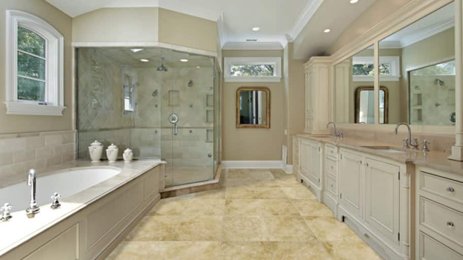 renovated bathroom with garden tub, walk-in shower, tile flooring and wood cabinetry