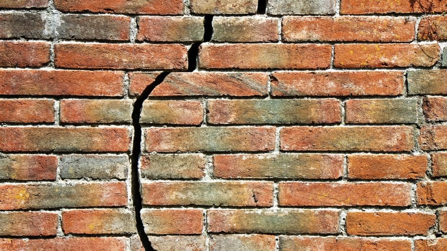 A large crack appears along a brick wall. (Photo by Photo courtesy of iStock)