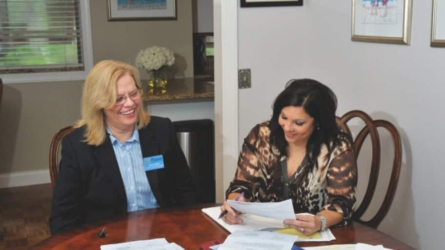Patient advocate Anna Inglett, with client Tammy Borden, assists with everything from insurance appeals to nursing home care coordination. (Photo by John Zambito)