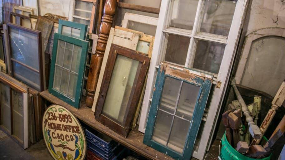 antique windows in salvage shop