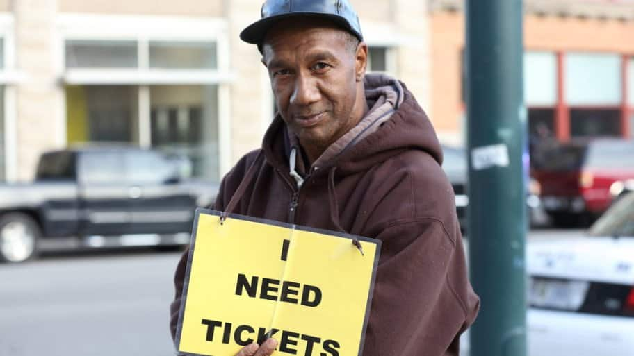 A ticket scalper outside of Bankers Life Fieldhouse in Indianapolis, Indiana before a Pacers game