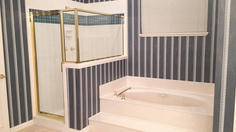 1990s bathroom with step-in tub and walk-in shower