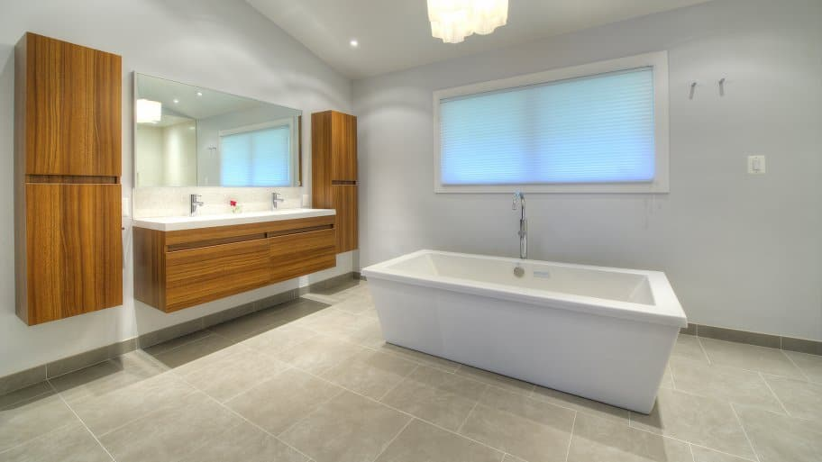 modern bathroom with floating cabinets
