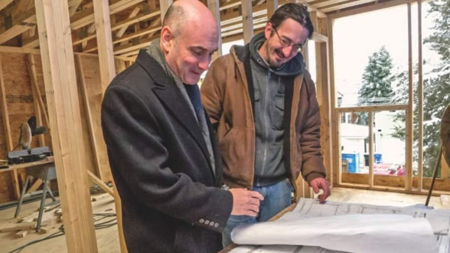 LEED AP Nate Kipnis (left) and contractor Nick Skoczen look over plans for a Chicago green building project. (Photo by Jay Madden)