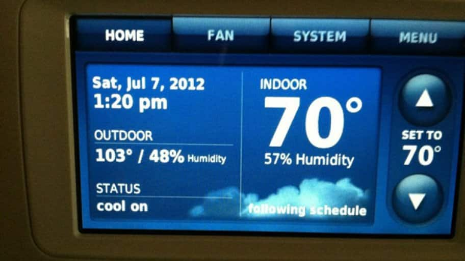 Digital thermostat showing indoor temperature of 70 degrees