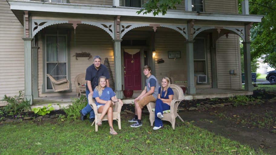 fender family portrait in front of their home