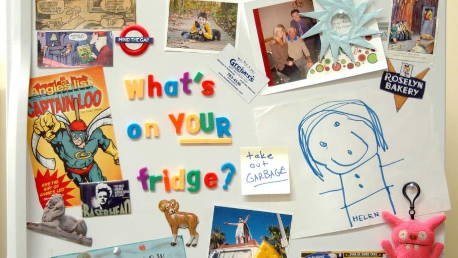 magnet letters and photos on fridge