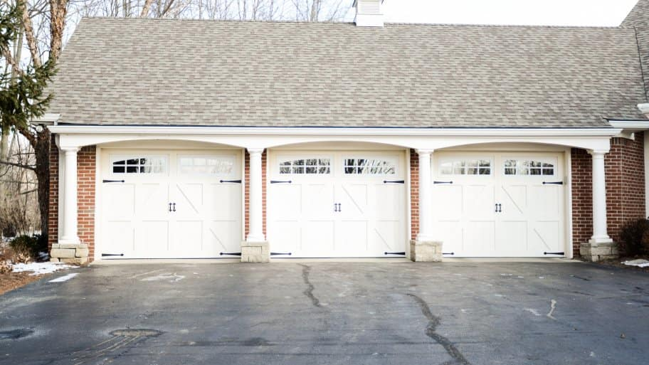 three overhead garage doors on house