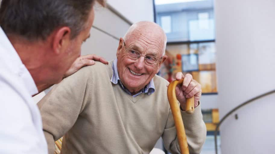 Senior man has a friendly conversation with his doctor