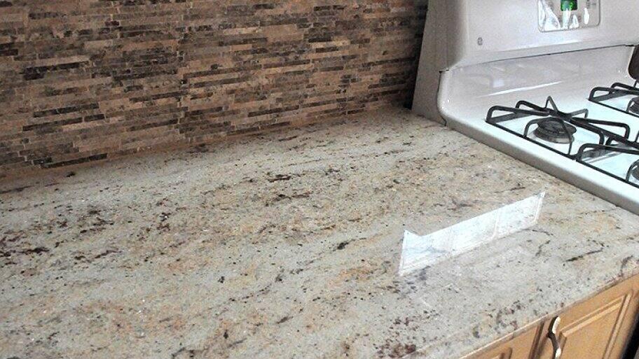 Granite Countertop And Stone Backsplash
