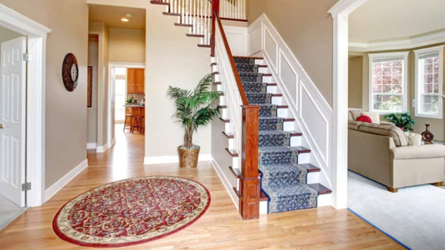 Beautiful interior of hardwood floor leading up to staircase.
