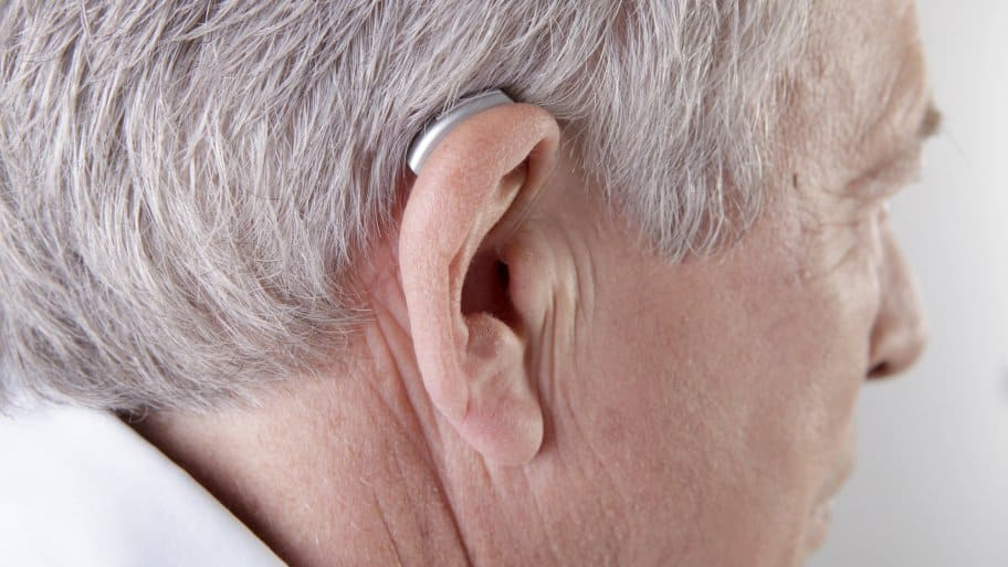 senior citizen with hearing aid