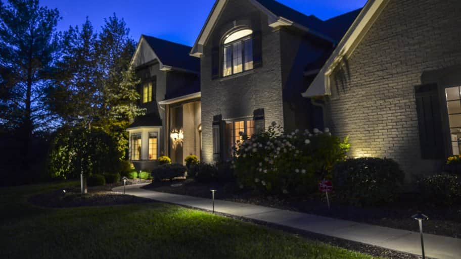 Why you should install outdoor lighting angies list outdoor lighting in front of indiana home and pathway mozeypictures Image collections