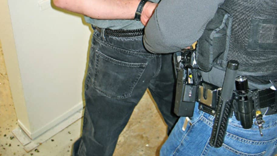 Police arrest an unlicensed contractor during a sting in California. (Photo courtesy of the California Contractors State License Board)
