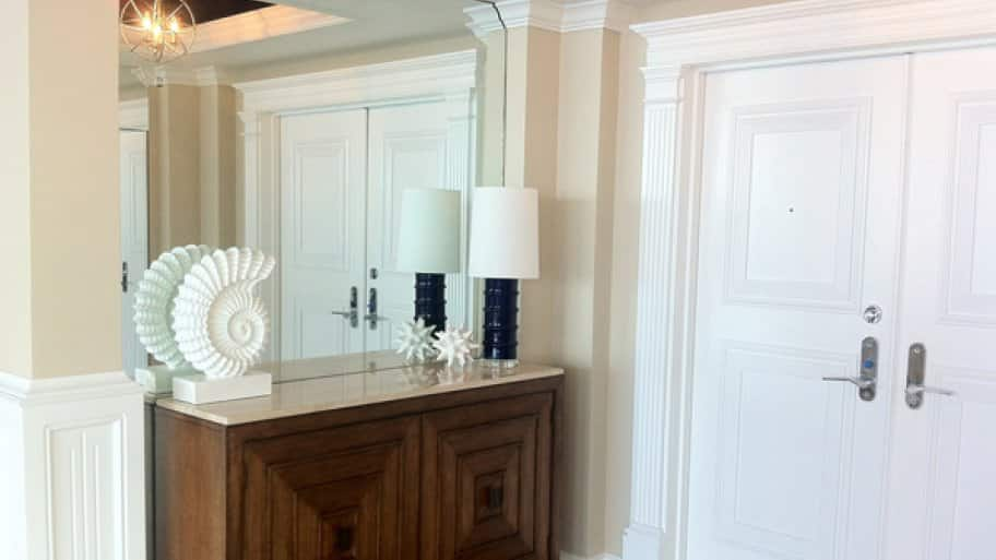 If you want to make a grand entrance, try placing a mirror in your foyer, says Marsh. (Photo courtesy of Kathryn Interiors, Inc.)