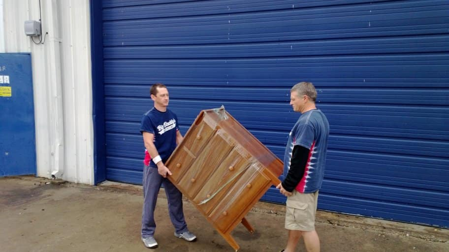 Two men move a dresser. (Photo by Photo courtesy of Big Daddy's Moving)