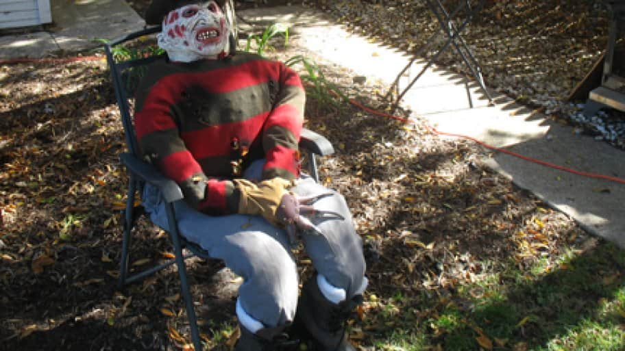 i made this freddy krueger dummy by stuffing last years halloween costume with leaves it didnt cost a penny and it makes me flinch every time i walk