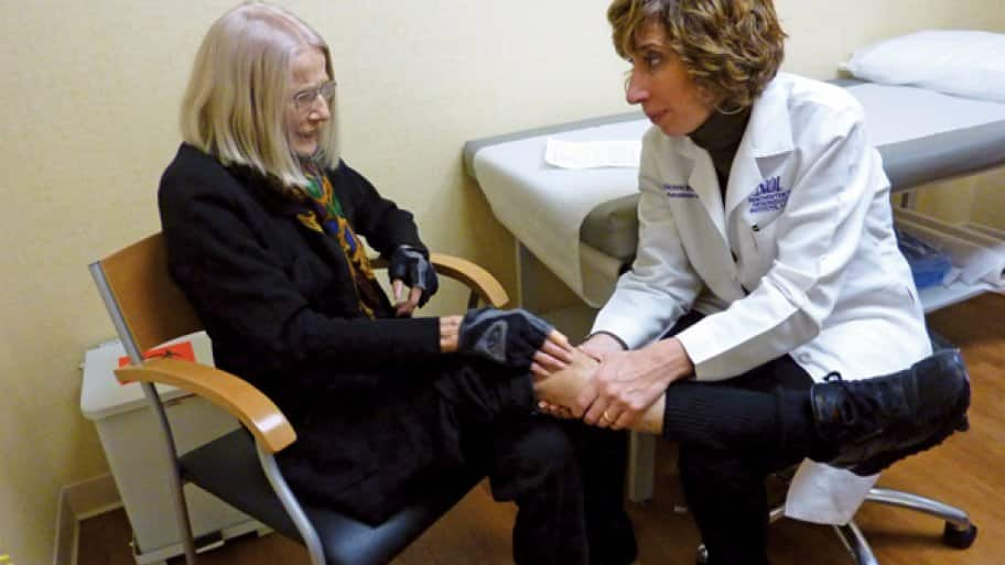 Dr. Victoria A. Brander evaluates patient Dagmar Weinberg, who combats arthritis with physical therapy and medication. (Photo courtesy of Roy Freeman)