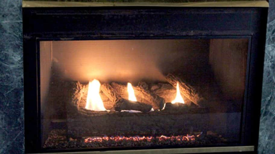 Gas logs can have the appearance of real wood while providing heat and similar benefits of wood-burning logs. (Photo courtesy of Chet Koczynski)