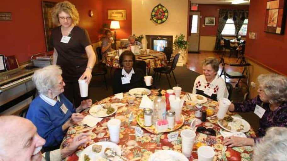 Residents at a nursing home share a holiday meal.