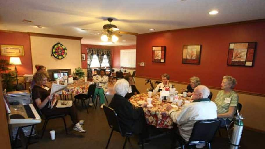 Nursing home residents sitting at table for a holiday meal.