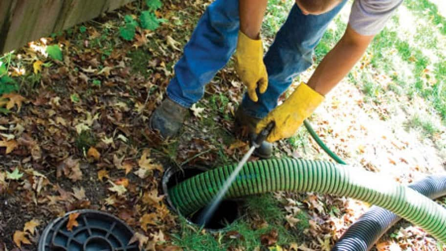 man flushing septic system